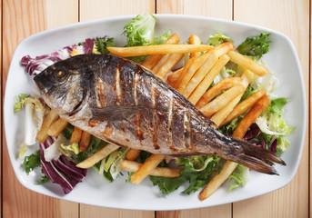 Grilled fish with salad and french fries
