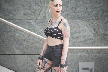 Young woman with dark makeup and tattoos