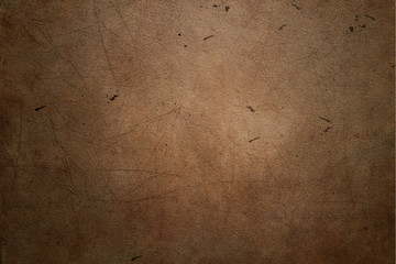Brown leather background with scratches