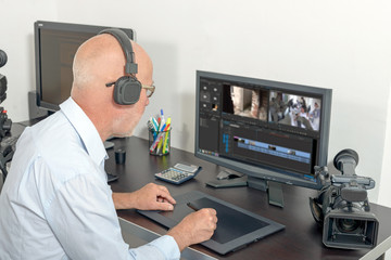 video editor in his studio