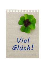 Papierblatt mit Glücksklee: Viel Glück