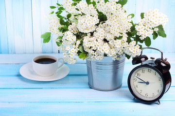 flower garden wooden morning coffee time alarm clock background gentle blue tone