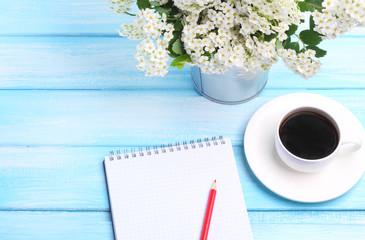 notebook marker flower garden wooden background gentle blue tone