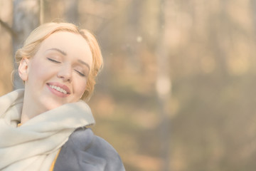 Portrait of young beautiful woman in autumn pullover. Blonde gir