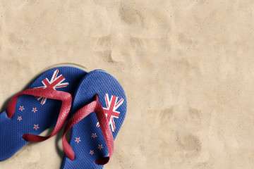 Thongs with flag of New Zealand, on beach sand