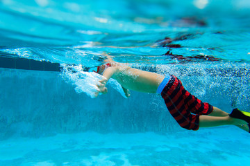 little boy swimming underwater, active kids