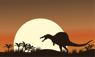 Silhouette of spinosaurus and big sun