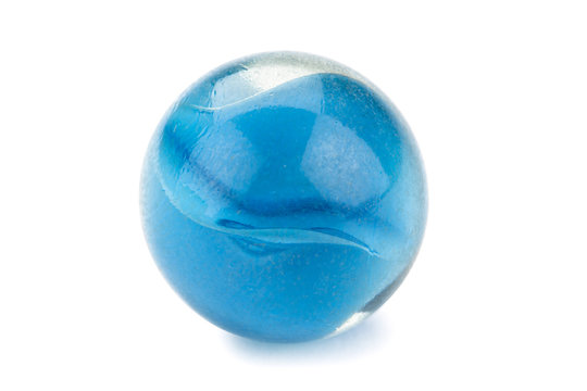 a piece of a blue marble ball