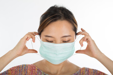 .Pollution mask ,asian woman push protection mask wearing for pr