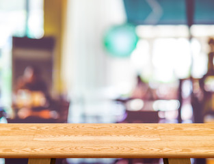 Empty wooden table and blurred cafe bokeh light background. Mock