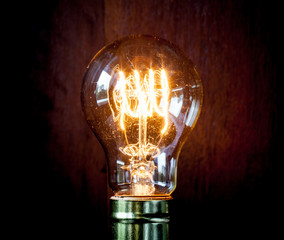 Classic Edison light bulb with looping carbon filament.