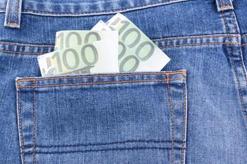 Euro money in jean pocket