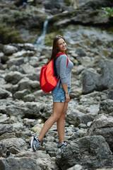 young beautiful girl climbing the rock