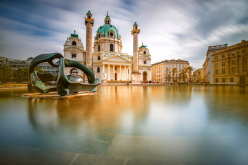 View on st. Charles's church on Karlsplatz in Vienna. Long exposure technic with blurred clouds and glossy water