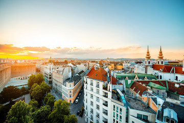 Garden Poster Vienna Panoramic cityscape view on Vienna city with Mariahilfer church towers on the sunset in Austria