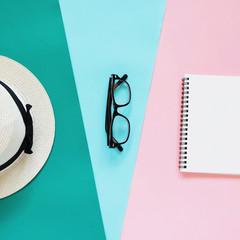 Creative flat lay photo of fashion style with eyeglasses, panama