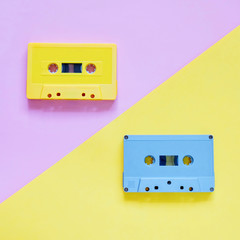 Retro cassette tapes on pastel color background, minimal style