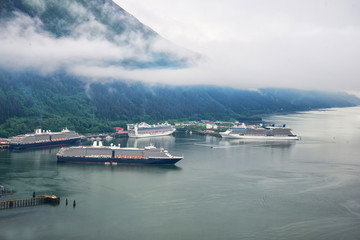Aerial view of cruise ships at port in Juneau, Alaska with snow