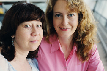 Portrait of two smiling 40 years old women