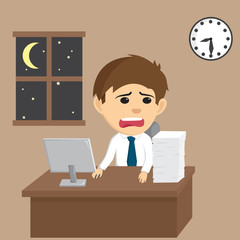 Businessman Working Late at Night and Look at a Clock
