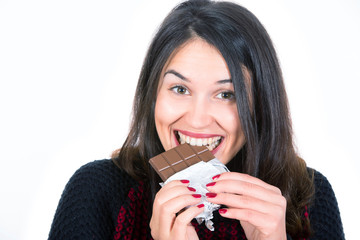 young woman eating chocolate isolated with white background