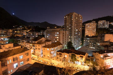 Apartment buildings and houses between hills of Rio de Janeiro in Laranjeiras district at night