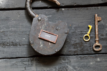 Open sign and old padlock
