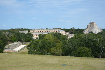 The Pyramid of the Magician and nunnery building in Uxmal. Yucatan Peninsula, Mexico. View from Governor's Palace.