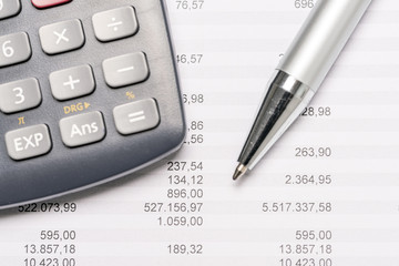 Documents with calculator and pen