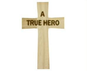 "Wooden cross with ""A TRUE HERO"" burnt in"
