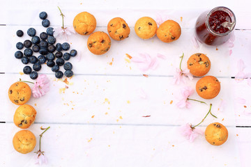 Rustic wooden breakfast background with bluberries, fresh scones and copy space