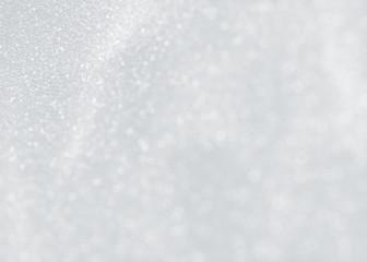 White sparkling ice texture of snowflakes