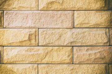 close-up of the yellow sandstone wall with vintage scene