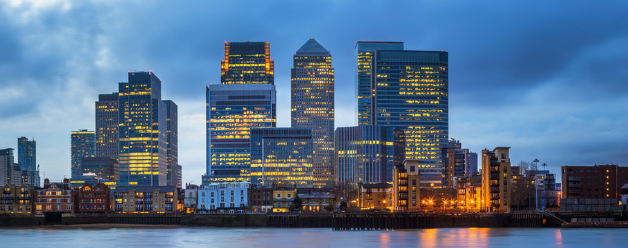 London, England - Canary Wharf, the famous business district and skyscrapers of London at blue hour