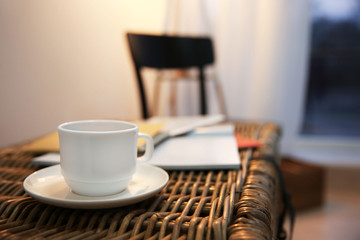 Cup of tea on wicker table, closeup