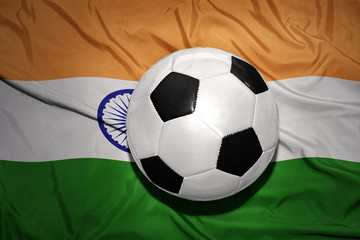 black and white football ball on the national flag of india