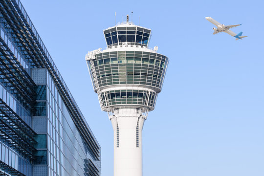 Munich international airport control tower and departing taking off