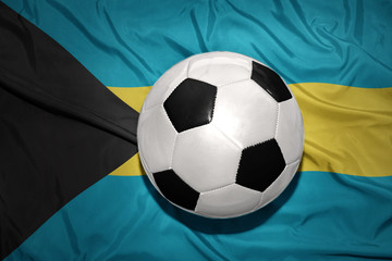 black and white football ball on the national flag of bahamas