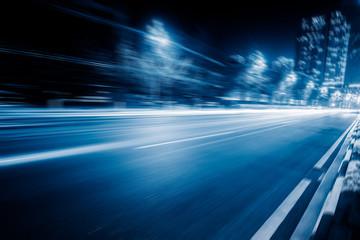 Fotobehang F1 blurred traffic in the daowntown center,chongqing china,blue toned image.