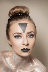 woman with silver & black makeup