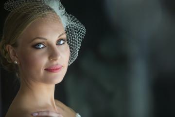 Closeup Portrait of beautiful  bride on elegant white dress - soft focus. Wedding hairstyle and Bridal make up.