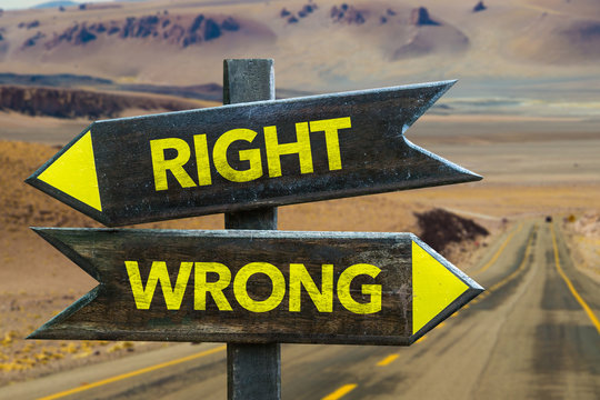 Right - Wrong crossroad in a desert background
