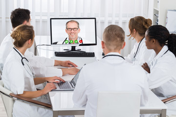 Doctors Videoconferencing On Computer In Hospital