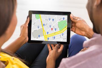 Couple Holding Digital Tablet