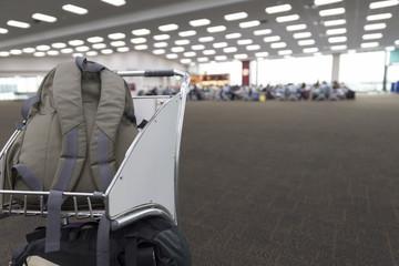 rucksack on cart in airport terminal building