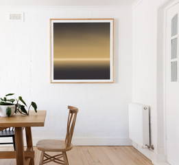 Framed print on white wall in danish styled interior dining room
