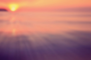 Blur tropical sunset beach with smooth wave abstract background.
