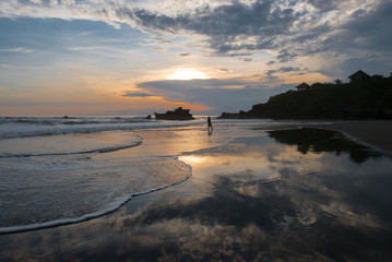 Colored sunset at Balian beach with silhouette of woman, Bali, I