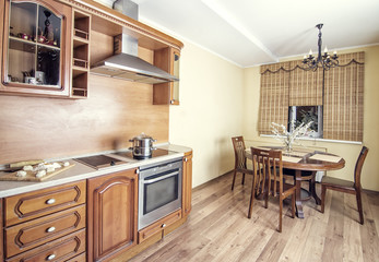 cooking on luxury kitchen with oven and wooden table