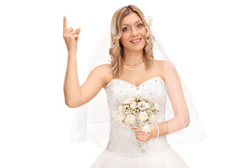 Cheerful bride pointing up with finger